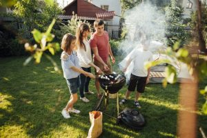 family-grilling-marshmallow-barbecue-grill-park_23-2148207941