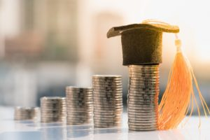 graduation-hat-top-coin-stack_86691-67