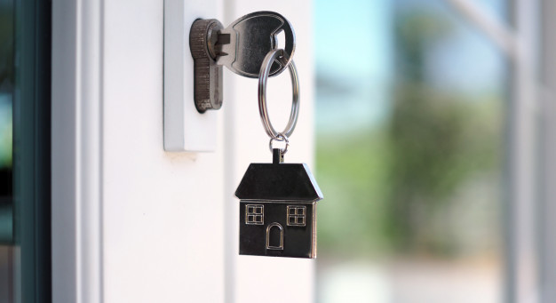 house-key-unlocking-new-house-is-plugged-into-door_112699-191