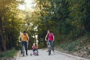family-with-bicycle-summer-park_1157-33548