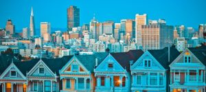 famous-painted-ladies-san-francisco-california-sit-glowing-amid-backdrop-sunset-skyscrapers_268835-2621