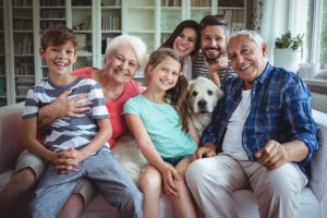 portrait-happy-family-sitting-sofa-living-room_107420-39271