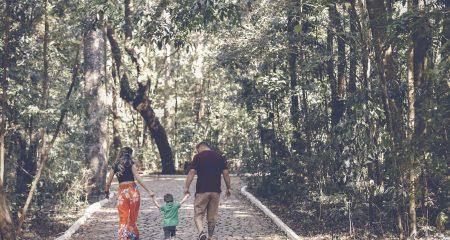 man-woman-and-child-walking-on-walkway-2880898-1