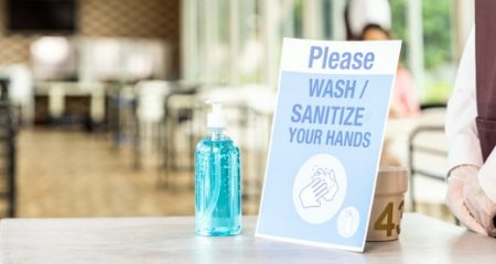 panorama-close-up-asian-waitress-stand-with-alcohol-gel-hand-sanitizer-with-its-signage-new-normal-restaurant-new-normal-hygiene-restaurant-lifestyle-concept_63253-8372